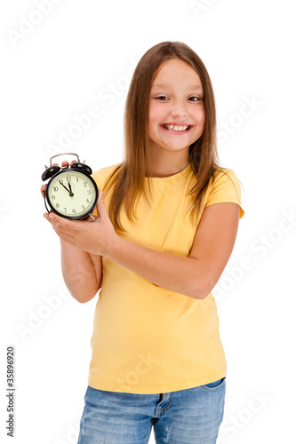 Fotografie, Obraz  Girl holding alarm-clock isolated on white background