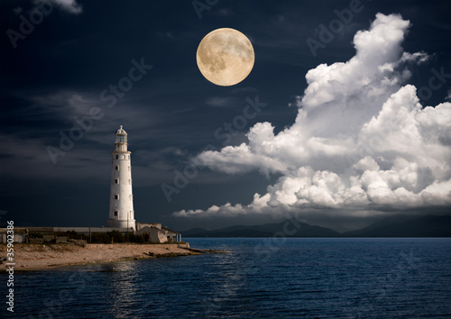 lighthouse at night. Fototapeta