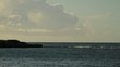 Waves brakes in Islet at the ocean bay in beach background sky