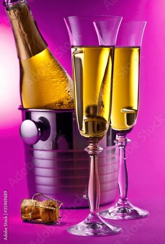 Champagne bottle in cooler - 35969689