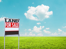 Land For Sale Sign On Empty Green Field