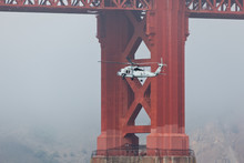 Navy Helicopter Passes Under G...
