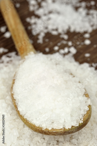 Coarse sea salt on a wooden spoon Slika na platnu