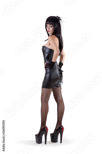 Fotografering  Dominant woman in fetish dress and extremely high heels