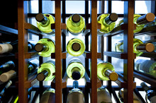 Wine Bottles In Wooden Rack