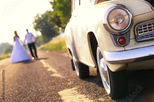 Fotografie, Obraz  Young wedding couple walk on the road