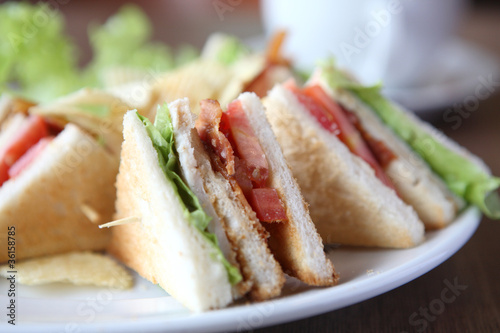 Staande foto Snack Club sandwich with coffee on wood background