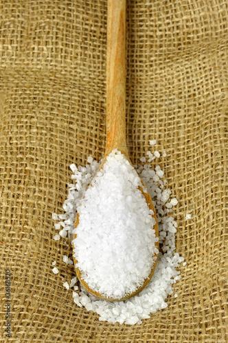 Fotografija  Coarse sea salt on a wooden spoon