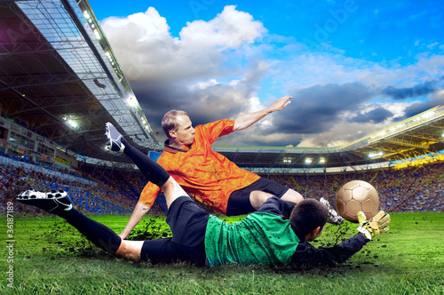 Poster voetbal Football player on field of stadium