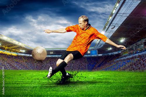 Fotobehang voetbal Football player on field of stadium