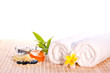 Spa concept with zen stone, bath salt, soap and flower