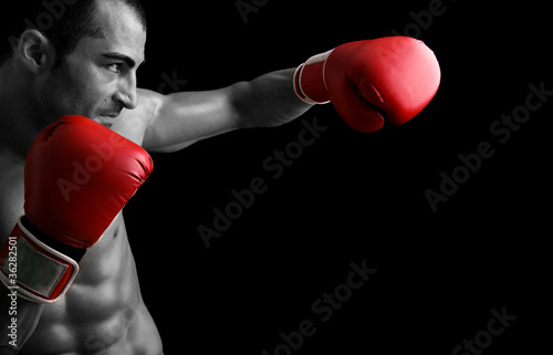 Photo  Young Boxer fighter over black background