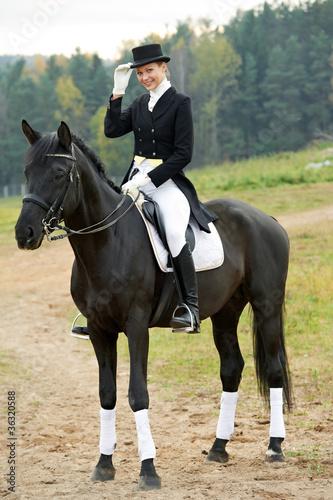Obraz na plátně horsewoman jockey in uniform with horse