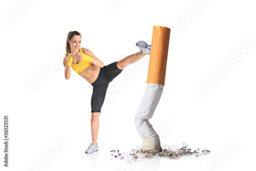 Fotografija  Girl kicking a cigarette butt