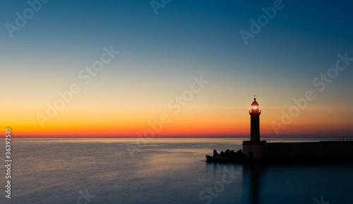 Foto op Aluminium Vuurtoren phare crépuscule