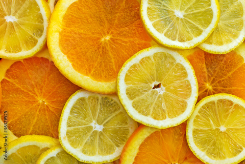 Staande foto Plakjes fruit Zitronen- und Orangenscheiben