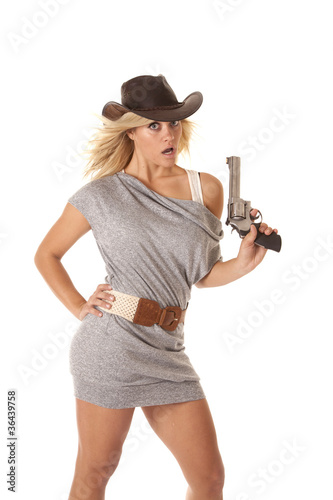 woman gun hand hip shock Poster