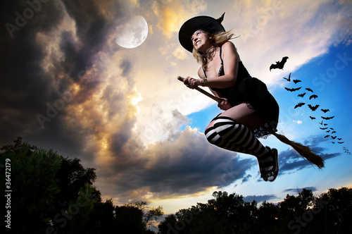 Fotobehang Volle maan Flying witch on broomstick