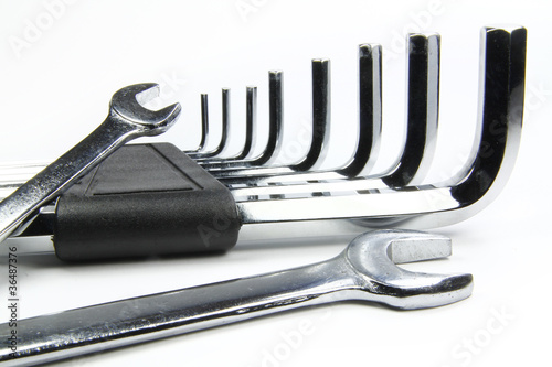 chrome wrenches on white background and allen