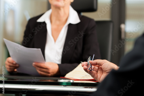 Photo Female Lawyer or notary in her office
