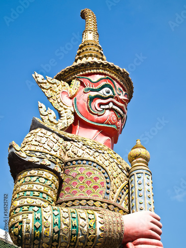Poster Bangkok The Red Giant Statue , Blue Sky on Background