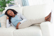 Woman on sofa putting her feet up