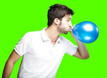 Man Blowing Balloon