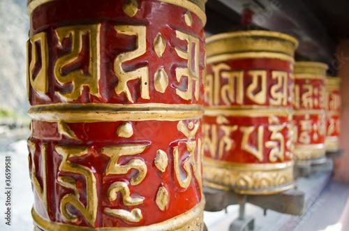 Staande foto Nepal red prayer wheels in nepal