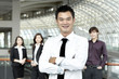 Business man with colleagues in the background
