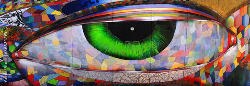 Spoed Foto op Canvas Graffiti looking eye on brick wall San Francisco