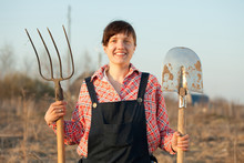 Happy  Farmer  With Spade And Pitchfork
