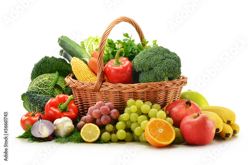 Poster Légumes frais Composition with vegetables and fruits in wicker basket isolated