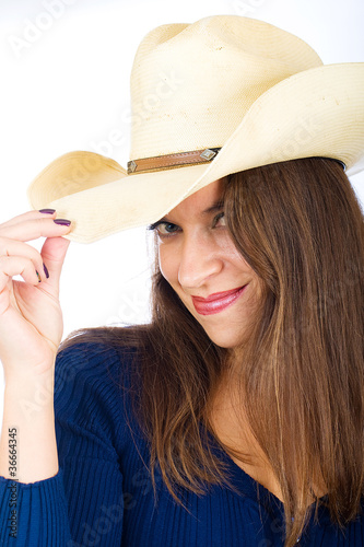 Friendly country girl tipping her cowboy hat - Buy this stock photo ... 6b7440f296ec