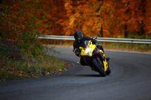 Man Riding With Speedbike In Autumn