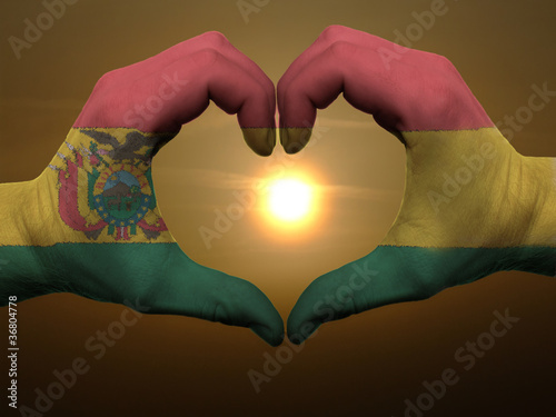 Poster Algérie Heart and love gesture by hands colored in bolivia flag during b