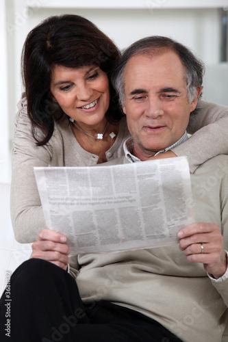 Couple reading newspaper Wallpaper Mural