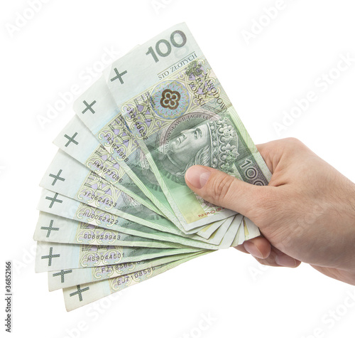 Fotografía  Polish money in hand. Clipping path included.
