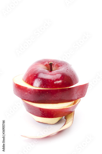 Vászonkép peal apple, red apple pealed and sliced put back to round shape.