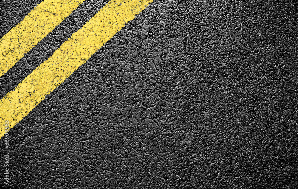 Fototapeta black asphalt yellow markings