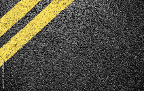 Photo black asphalt yellow markings