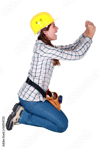 Construction worker on her knees begging Canvas Print