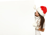 Girl In Santa Hat Looking Out From Behind  Blank Billboard,