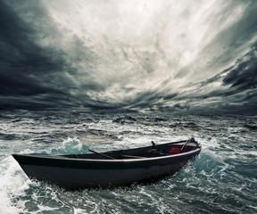 FototapetaAbandoned boat in stormy sea