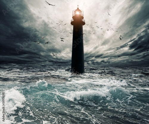 Stormy sky over flooded lighthouse Slika na platnu