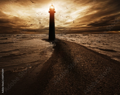 Stormy sky over  lighthouse Canvas