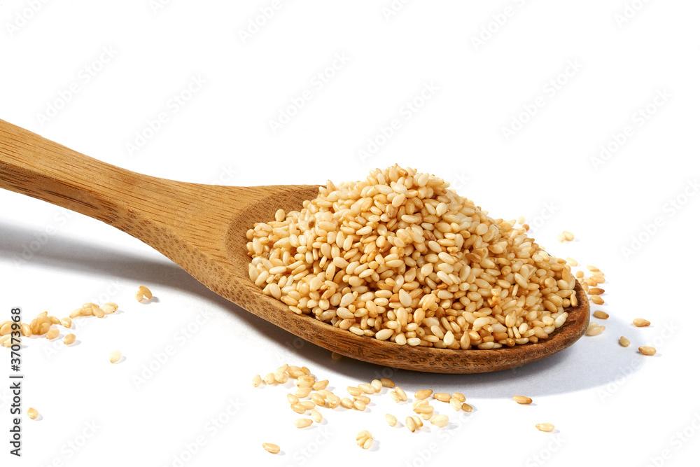 Fototapety, obrazy: Sesame grains in large wooden spoon