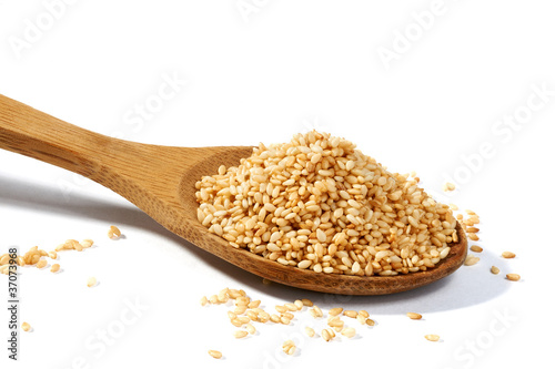Sesame grains in large wooden spoon