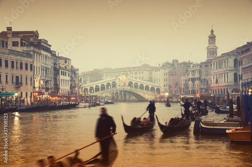 Aluminium Prints Venice Rialto Bridge and gondolas at a foggy autumn evening in Venice.