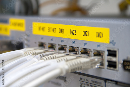 Fotografía  Ethernet cables connected to a Firewall