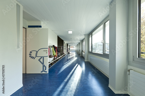 Obraz na płótnie modern public school,  corridor blue floor